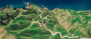 Moutainous trail leading to ocean