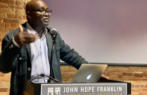 "Achille Mbembe, a philosophy scholar at the University of the Witwatersrand in Johannesburg, South Africa, gives the keynote address at the Challenging Borders conference. The event was held at Duke University on Nov. 18, 2019. (Amanda Solliday / Office of Global Affairs) ""Many borders are decided in places that aren't at the edges of nations or represented by a fence,"" said Piot, a professor of cultural anthropology and African and African American studies and a leading researcher in the economy and histor"