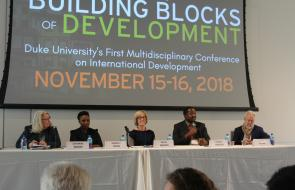 Image of panelists at the Conference on International Development