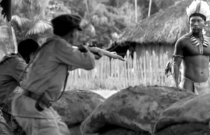 2 men shooting another man-still from the movie embrace of the serpent