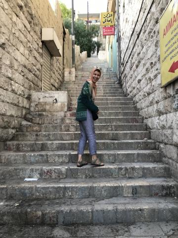 Student in headscarf on stairs