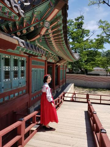 Student in traditional Korean clothing at Korean temple