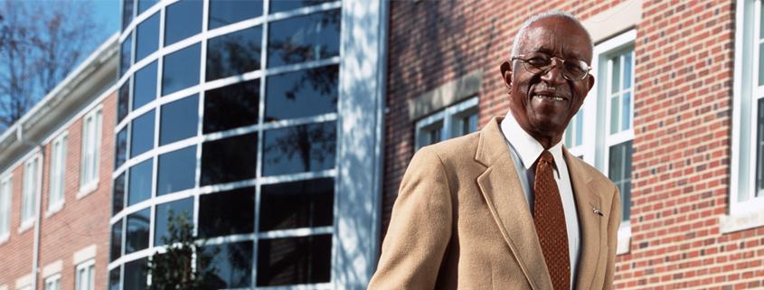 Dr. John Hope Franklin in front of the Franklin Center